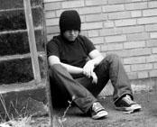 troubled-teen-boy-hat-sitting1